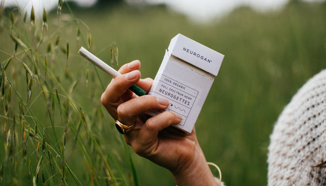 cbd cigarettes for Smoking CBD held by a girl in a field